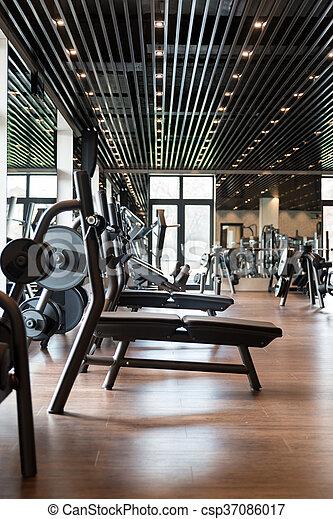 Modern Gym Interior With Equipment - csp37086017
