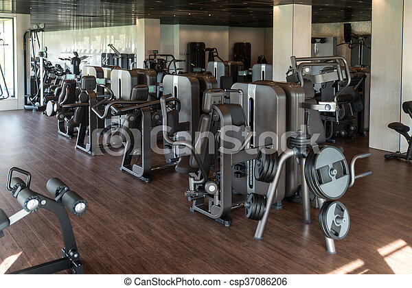 Modern gym interior with equipment equipment and machines at the