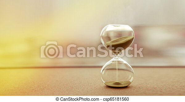 Modern hourglass with sand color background, as time passing concept for business deadline, urgency and running out of time - csp65181560