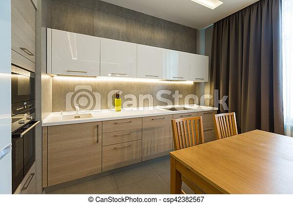 Modern kitchen interior in new luxury home, apartment - csp42382567