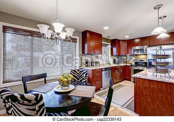 Modern kitchen interior with dining area - csp22339143