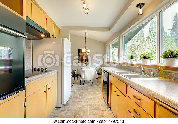 Modern kitchen with a small dining area - csp17797543