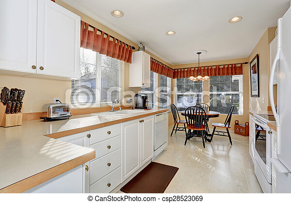 Modern kitchen with dinning area. - csp28523069