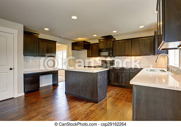 Modern kitchen with stained cabinets. - csp29162264