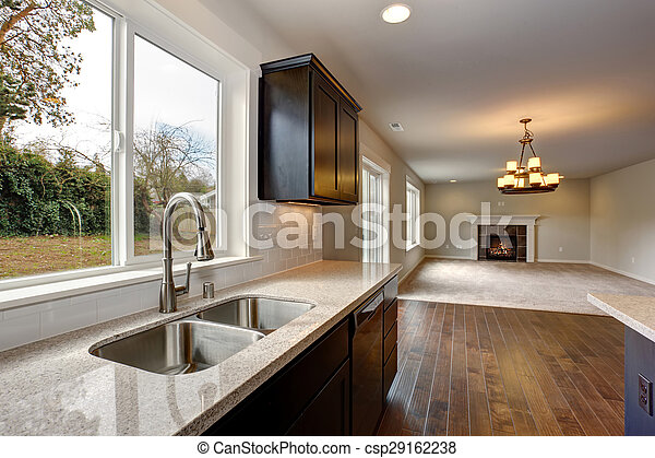 Modern kitchen with stained cabinets. - csp29162238