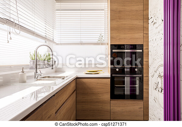 Modern Kitchen With Wood Accents An Iron Sink And Two Chopping Boards Next To A Microwave And An Oven Canstock