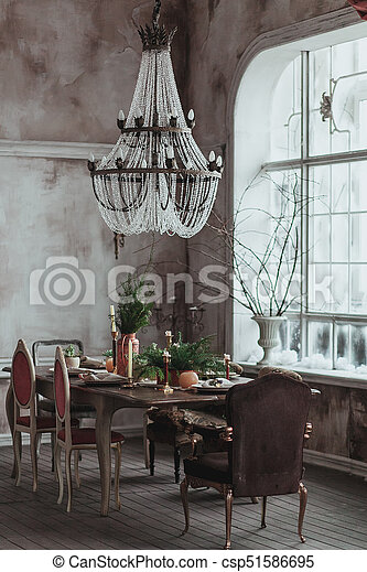 Modern Loft Dining Room With High Ceiling Vintage Armchairs Empty Grey Concrete Wall Wooden Floor Dining Table With Dishes Flowers And Candles