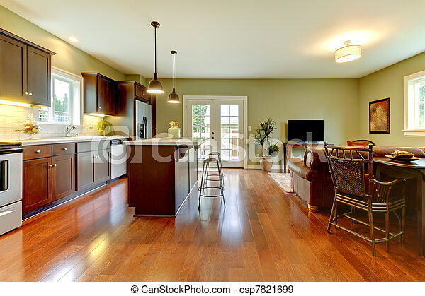 Modern new brown kitchen with cherry floor and living room.. Modern ...