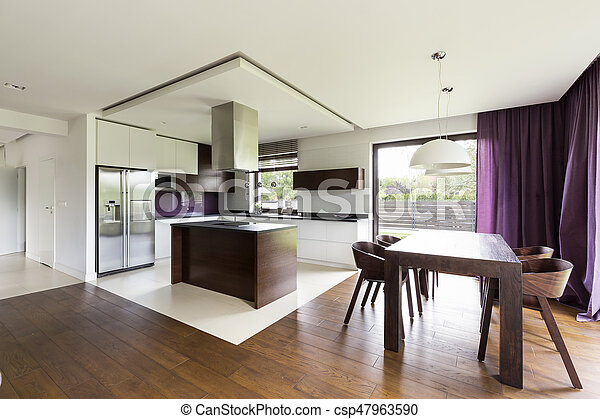 Modern open kitchen with wooden table - csp47963590