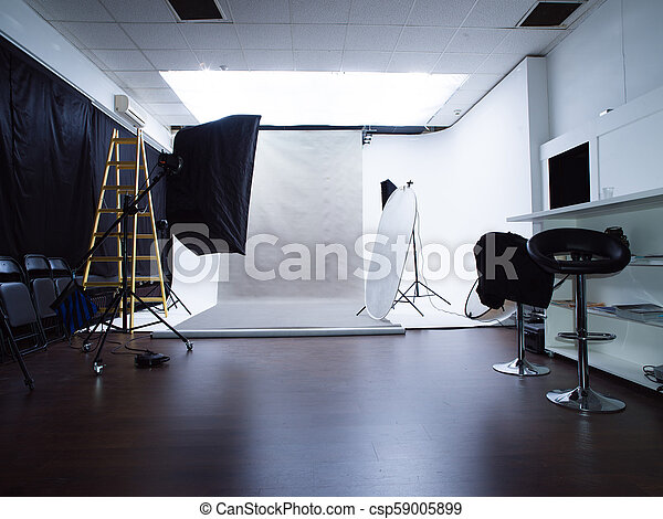 Modern Photo Studio Interior With Professional Lighting Equipment