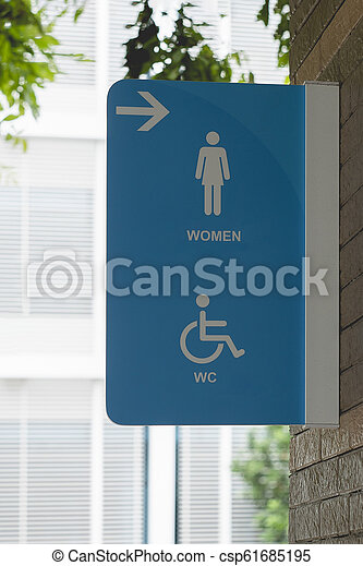 Modern public toilet sign on wall ,Women WC signs for restroom. - csp61685195