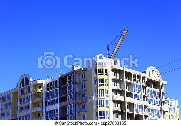 modern skyscraper with hoisting crane - csp27003185
