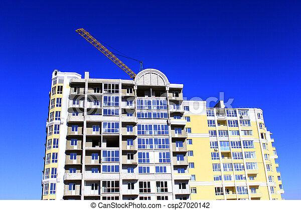 modern skyscraper with hoisting crane - csp27020142