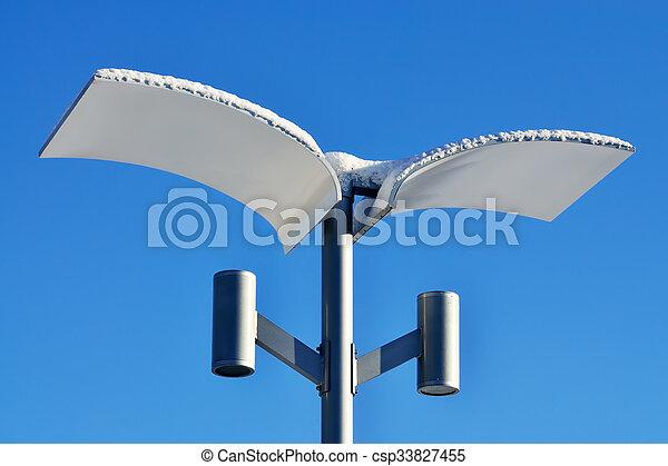 Modern street lamp in winter - csp33827455
