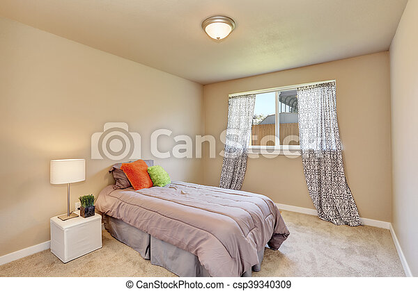 Modern teen bedroom interior with grey bedding.