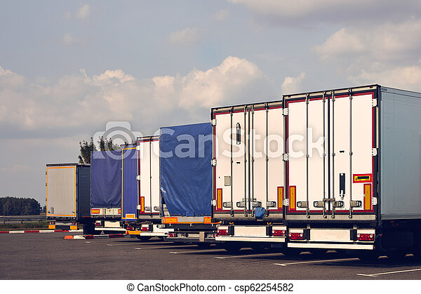 Modern trucks of various models are in a row on truck stop. - csp62254582