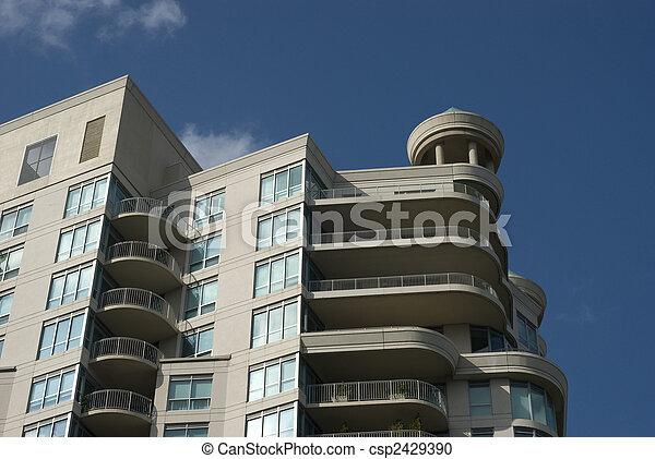 Modern unique condominium building with turret. - csp2429390