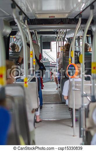 Modern urban bus interior with passengers and validator - csp15330839