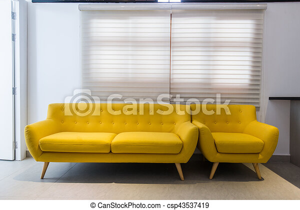 Modern Yellow Sofa And Chair In Room Interior At Home Or Hotel