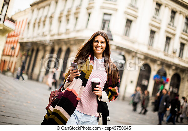 Modern young woman on the street - csp43750645