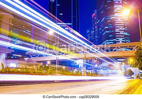 Rastros de luz en la calle moderna, Hong Kong. - csp28329509