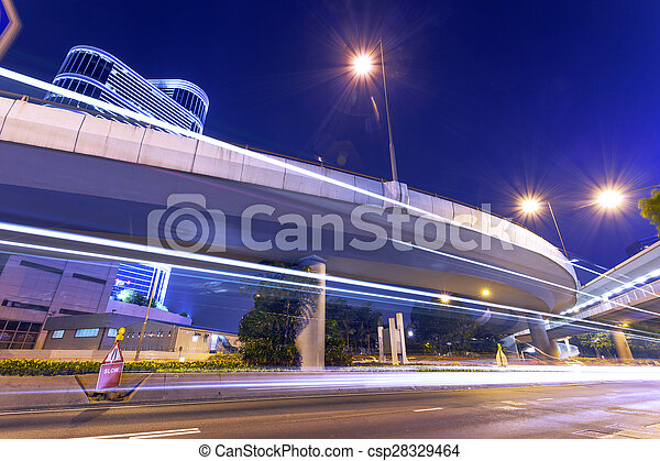 Rastros de luz en la calle moderna, Hong Kong. - csp28329464