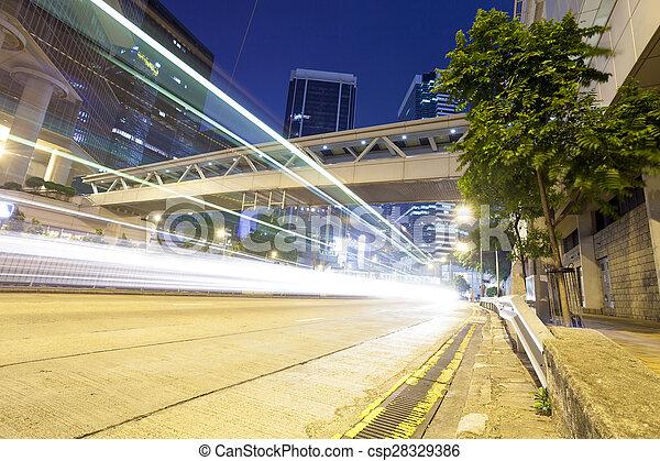 Rastros de luz en la calle moderna, Hong Kong. - csp28329386