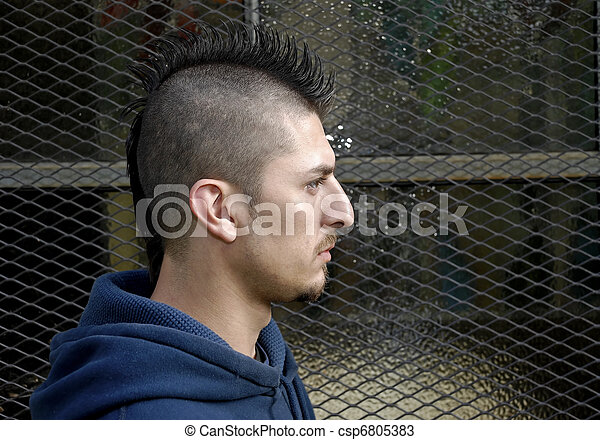 Profile portrait of hispanic man with spiked mohawk against stock mohawk csp6805383 winobraniefo Choice Image