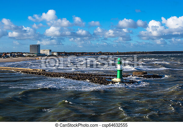 Mole on the Baltic Sea coast in Warnemuende, Germany - csp64632555