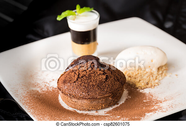 Molten chocolate cake with peanut butter shooter. - csp82601075