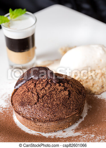 Molten chocolate cake with peanut butter shooter. - csp82601066