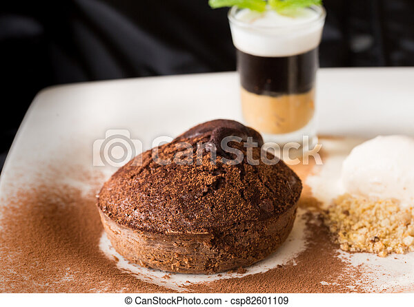 Molten chocolate cake with peanut butter shooter. - csp82601109