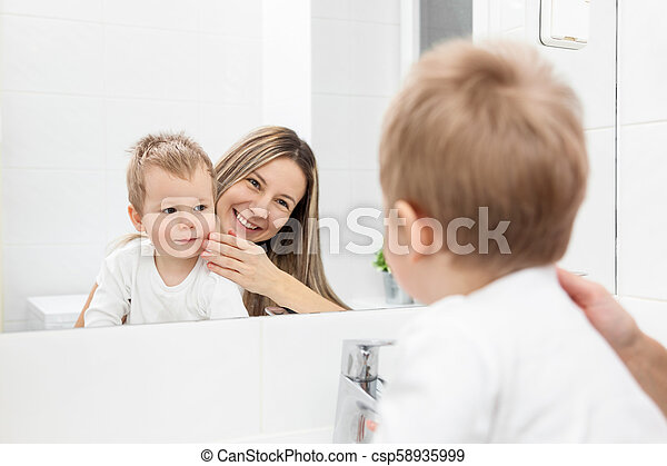 Mom Helps Son In Bathroom