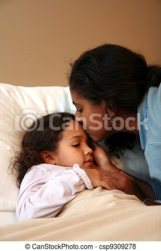 Mom Tucking Child into Bed - csp9309278