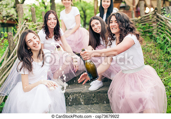 Moment of champagne bottle opening while hen party - csp73679922