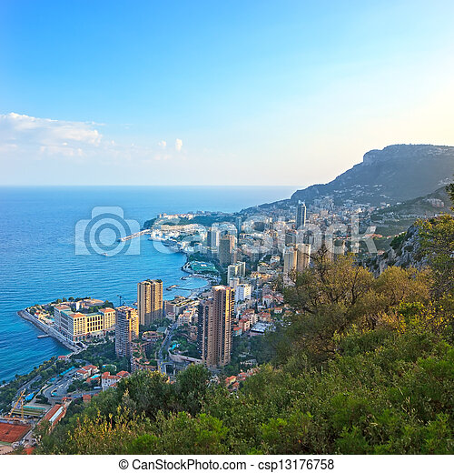 Monaco Montecarlo principality aerial view cityscape on sunset. Skyscrapers, coastline, port and old city. Azure coast. France, Europe. - csp13176758