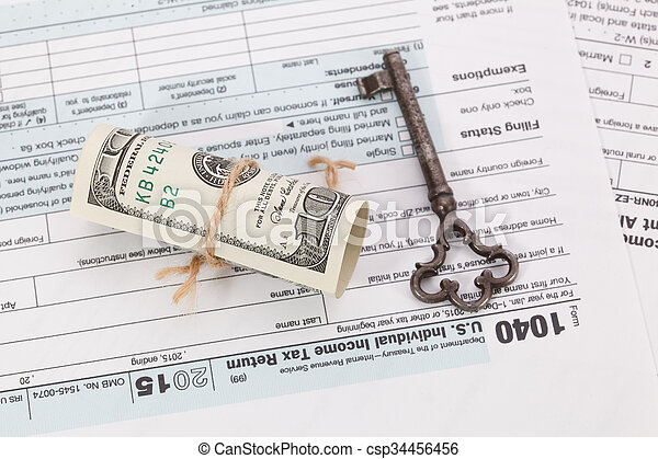 Money and key on tax form background - csp34456456