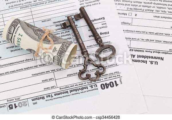Money and key on tax form background - csp34456428