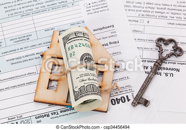 Money and wooden house with vintage key on tax form background - csp34456494