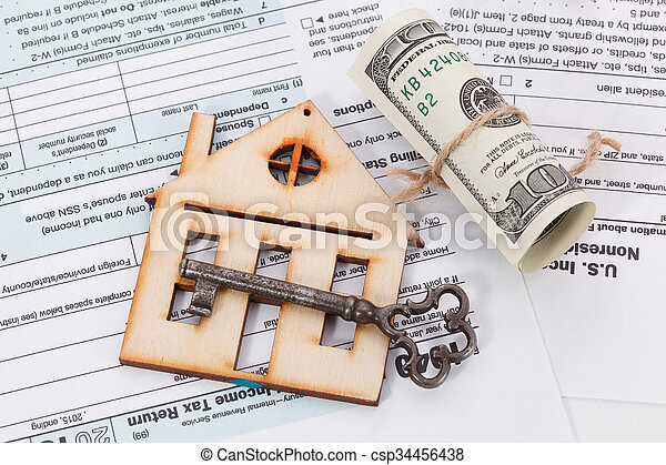 Money and wooden house with vintage key on tax form background - csp34456438