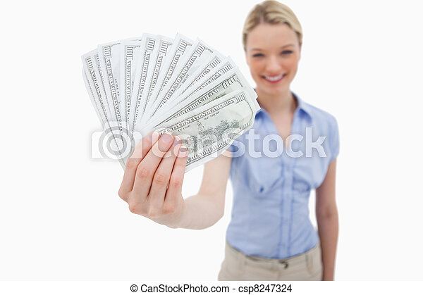 Money being held by smiling woman - csp8247324