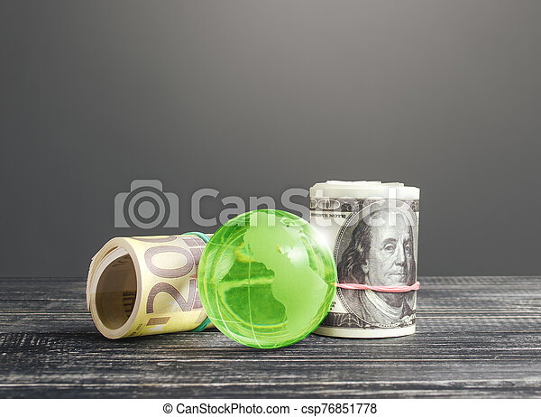 Money bundle rolls world currencies and a green glass globe. Capital investment, savings. Profit income, dividends payouts. Crowdfunding startups investing. Banking service, budget monetary policy - csp76851778