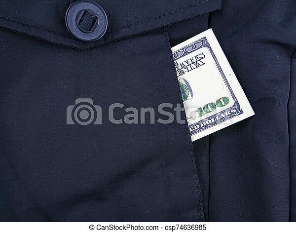 Money dollars in a jacket pocket. - csp74636985