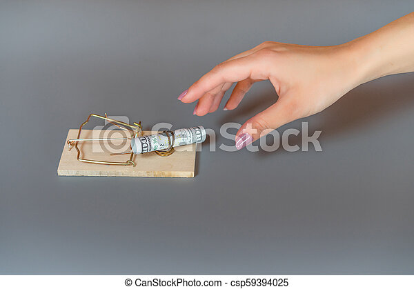 Money dollars in a mousetrap - csp59394025