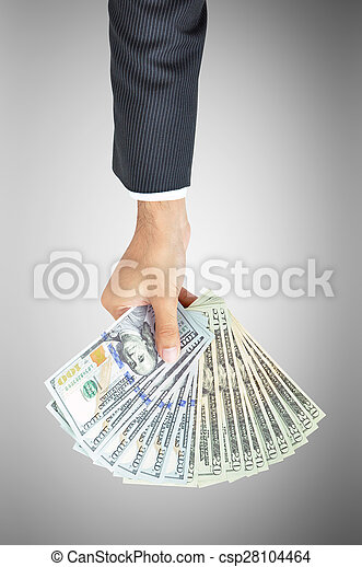 Money - hand holding banknotes - United States Dollars or USD - csp28104464
