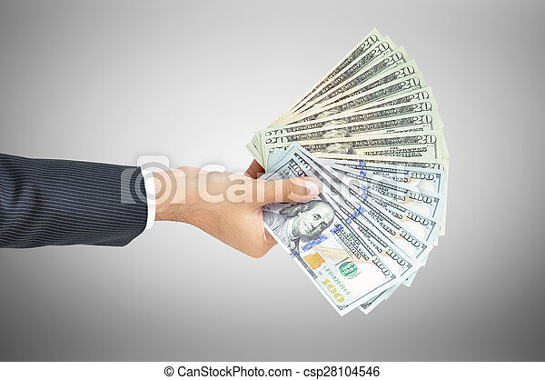 Money - hand holding banknotes - United States Dollars or USD - csp28104546