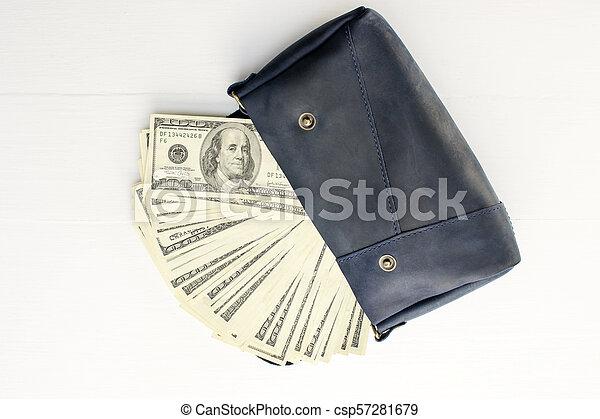 Money in bag on white background. - csp57281679