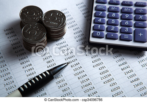 money in the form of banknotes and coins with calculator - csp34096786
