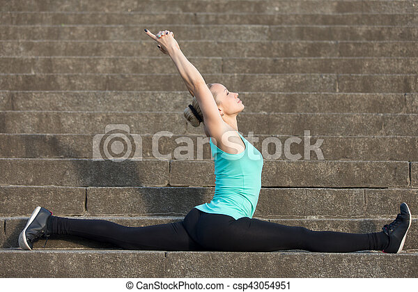monkey god pose sporty attractive young woman practicing