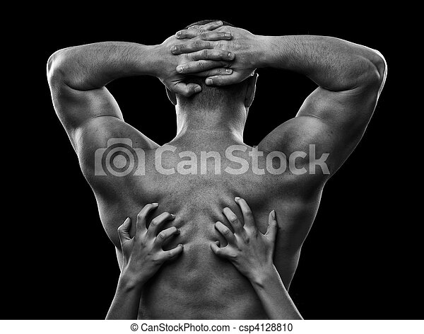 Monochrome image of a man\'s back and woman\'s hands - csp4128810